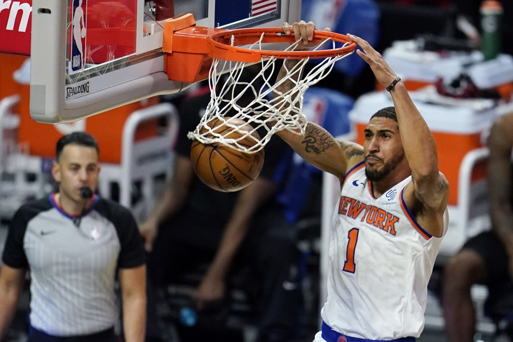 New York Knicks forward Obi Toppin dunks against the Los Angeles Clippers during the second half of an NBA basketball game Sunday, May 9, 2021, in Los...