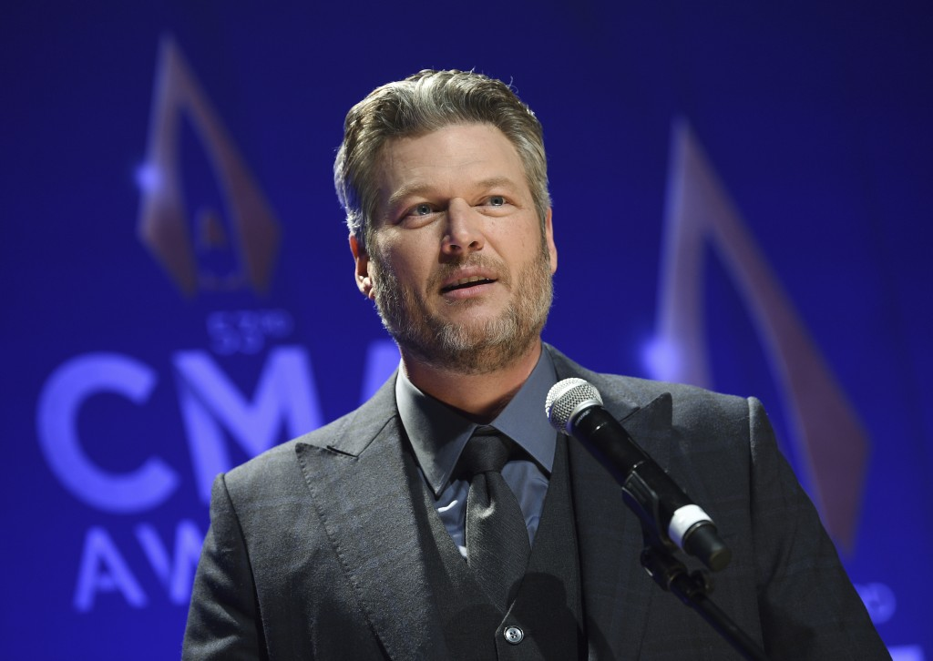 """FILE - In this Nov. 13, 2019, file photo, singer Blake Shelton speaks in the press room after winning single of the year award for """"God's Country"""" at ..."""