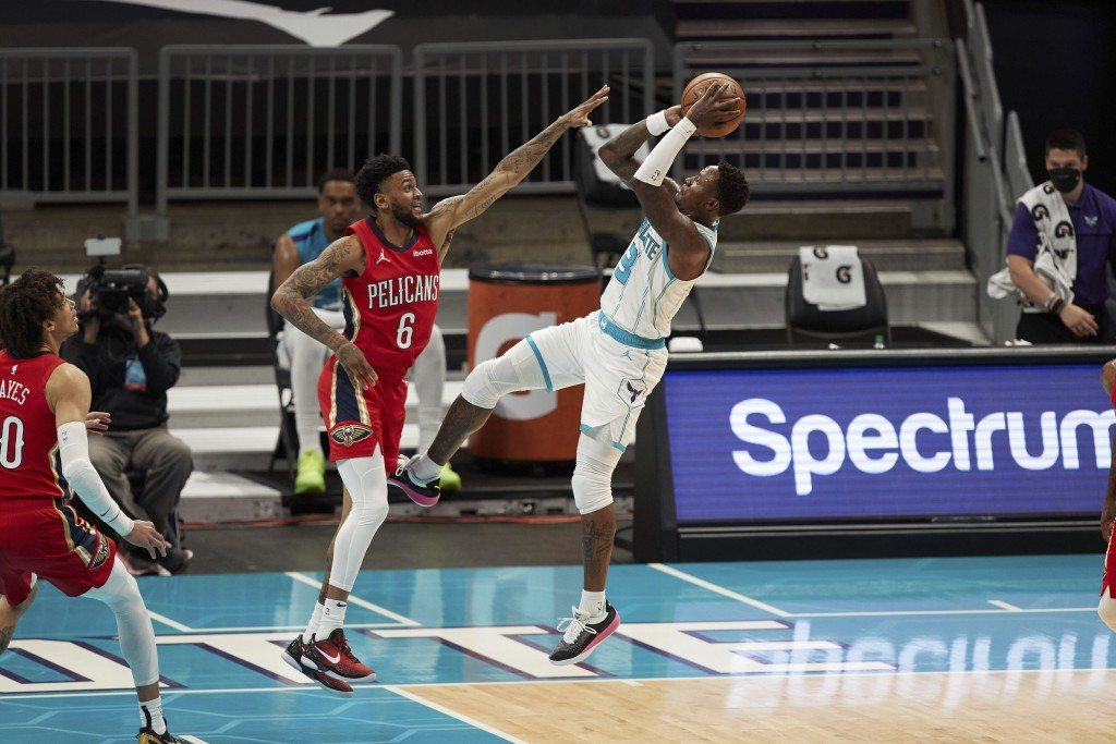 Charlotte Hornets guard Terry Rozier (3) shoots over New Orleans Pelicans guard Nickeil Alexander-Walker (6) during the first half of an NBA basketbal...