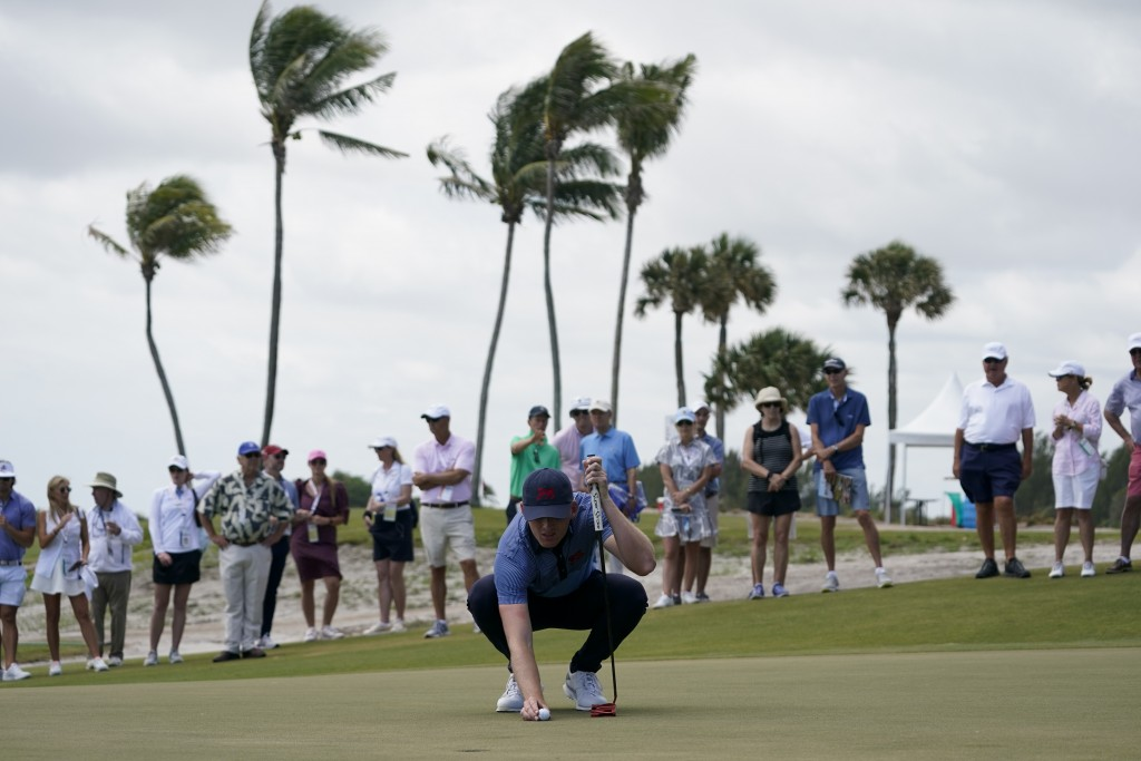 Jack Dyer, of the Great Britain and Ireland team, lines up a putt on the 11th hole in the foursome matches during the Walker Cup golf tournament at th...
