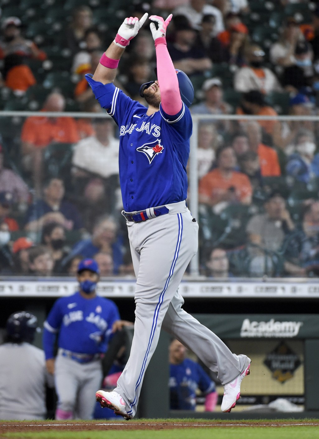 Toronto Blue Jays' Rowdy Tellez celebrates his solo home run during the fifth inning of a baseball game against the Houston Astros, Sunday, May 9, 202...