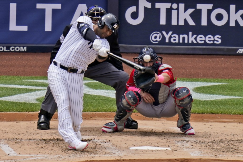 New York Yankees' Aaron Hicks hits an RBI-single during the third inning of a baseball game against the Washington Nationals at Yankee Stadium, Sunday...