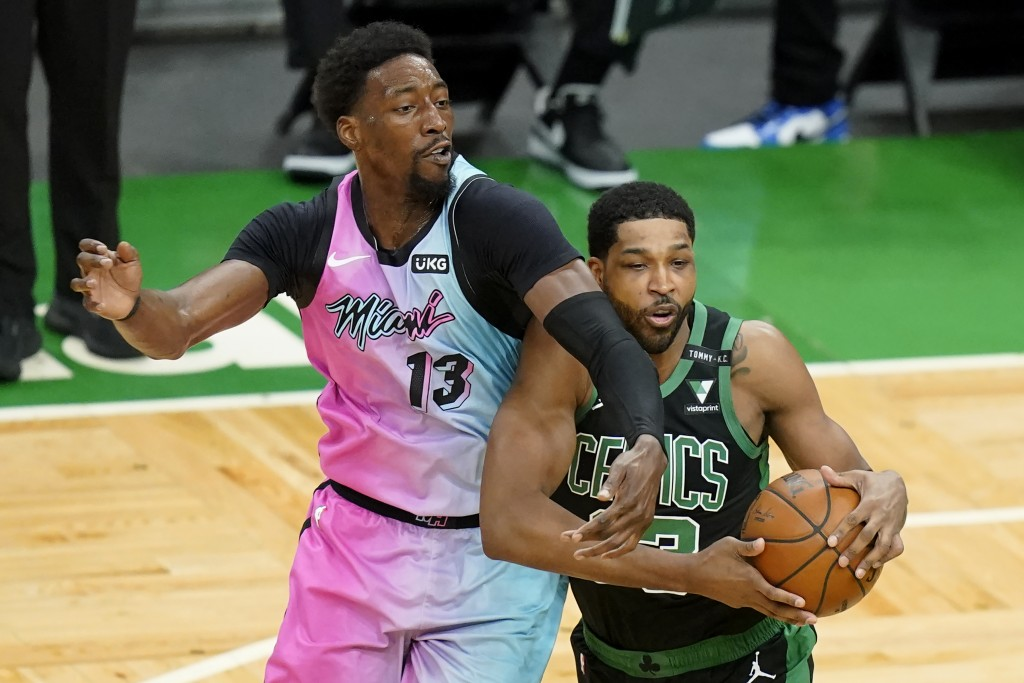 Miami Heat's Bam Adebayo, left, vies for control of the ball with Boston Celtics' Tristan Thompson, right, in the first half of a basketball game, Sun...