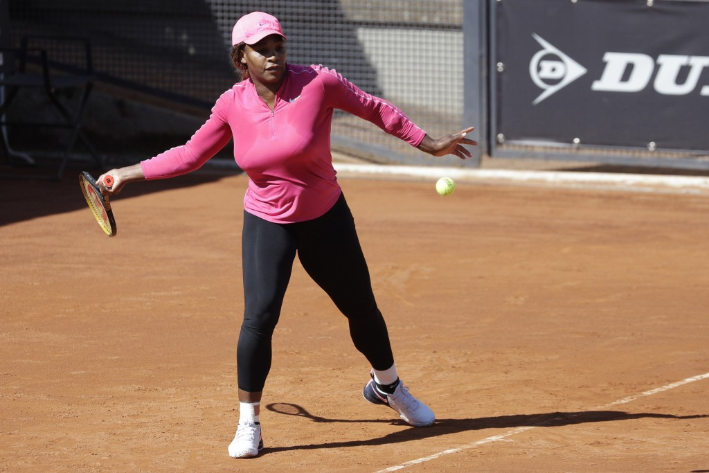 Serena Williams returns the ball during a training session at the Italian Open tennis tournament, in Rome, Monday, May 10, 2021. (AP Photo/Gregorio Bo...