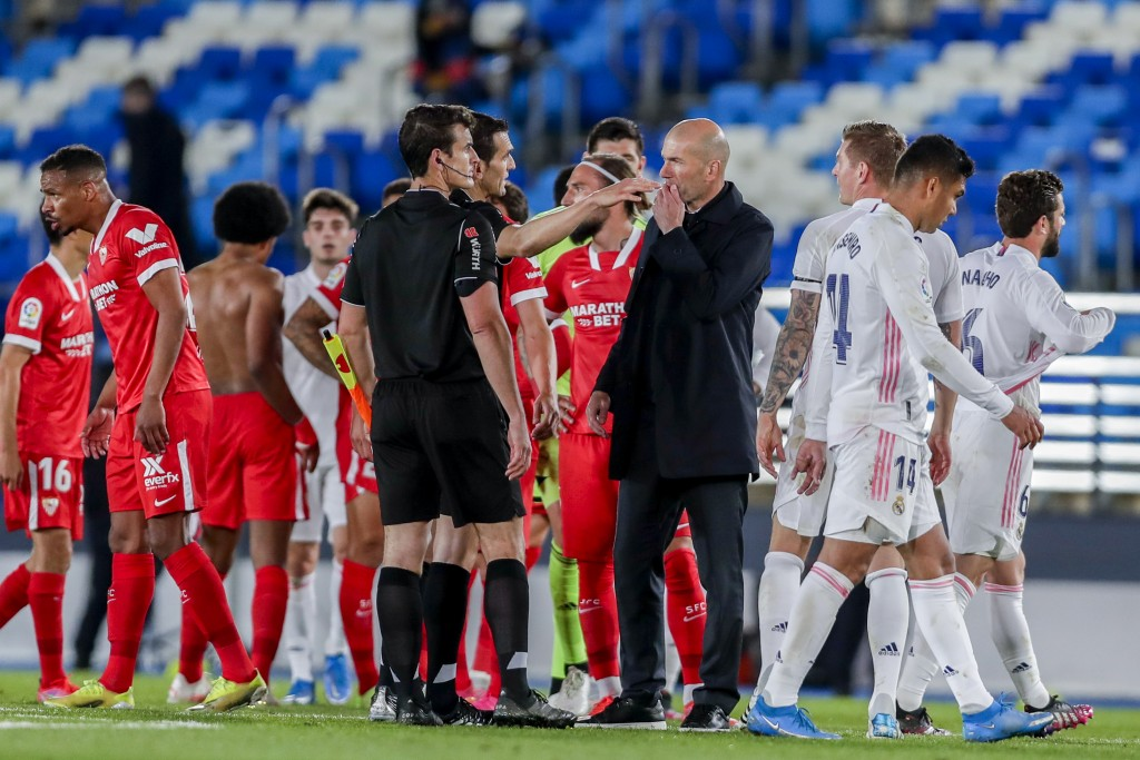 Real Madrid's head coach Zinedine Zidane talks with the referre at the end of the Spanish La Liga soccer match between Real Madrid and Sevilla at the ...