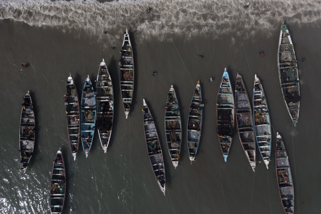 Fishing boats line the shore of Bargny beach, some 35 kilometers (22 miles) east of Dakar, Senegal, Thursday April 22, 2021. In Bargny and other coast...