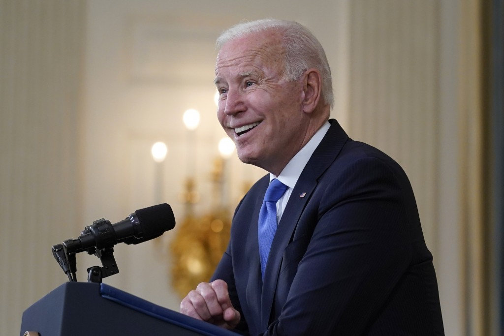 FILE - In this May 5, 2021, file photo President Joe Biden takes questions from reporters as he speaks about the American Rescue Plan, in the State Di...
