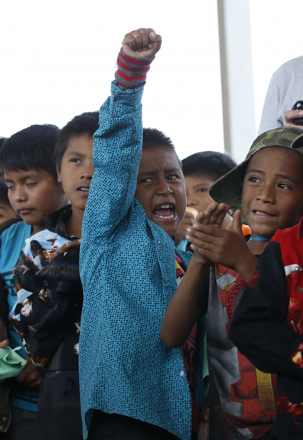 Children cheer for community policemen who delivered toys as part of the Children's Day festivities in Alcozacan, Guerrero state, Mexico, Friday, Apri...