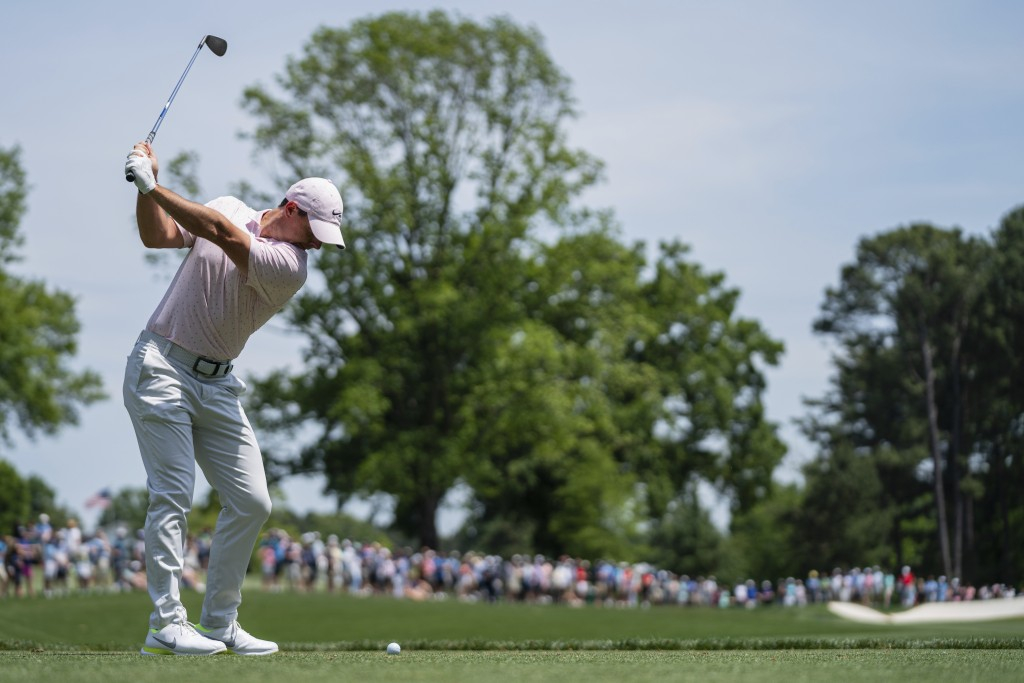 Rory McIlroy tees off on the fourth hole during the fourth round of the Wells Fargo Championship golf tournament at Quail Hollow on Sunday, May 9, 202...