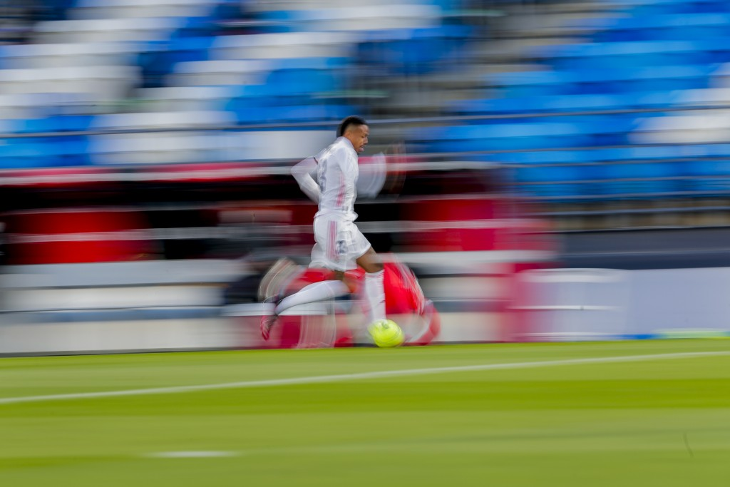 Real Madrid's Eder Militao runs with the ball during the Spanish La Liga soccer match between Real Madrid and Sevilla at the Alfredo di Stefano stadiu...