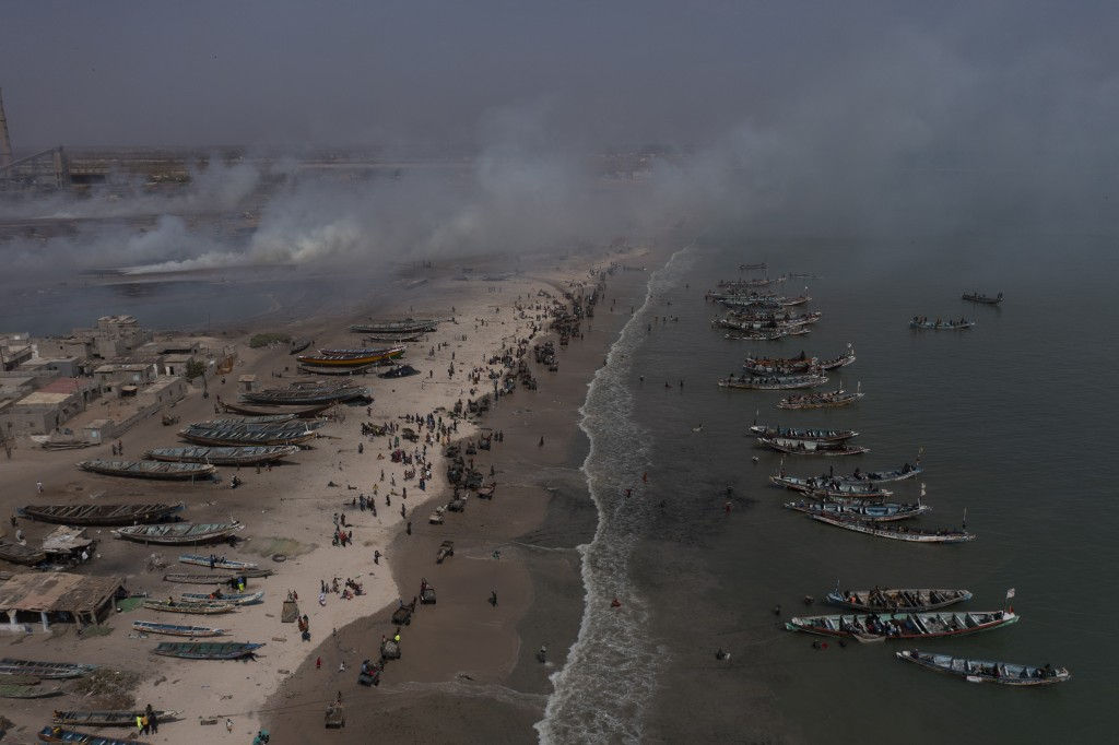 Fishing boats line the shore of Bargny beach, some 35 kilomters (22 miles) east of Dakar, Senegal, Thursday April 22, 2021. In Bargny and other coasta...