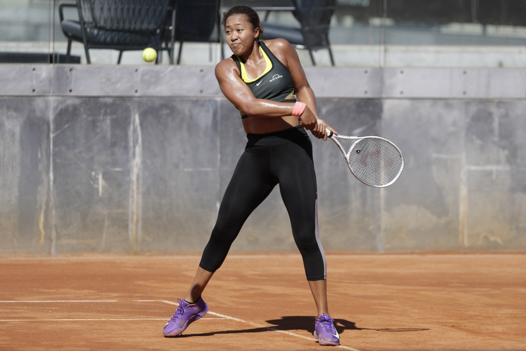 Japan's Naomi Osaka returns the ball during a training session at the Italian Open tennis tournament, in Rome, Monday, May 10, 2021. (AP Photo/Gregori...