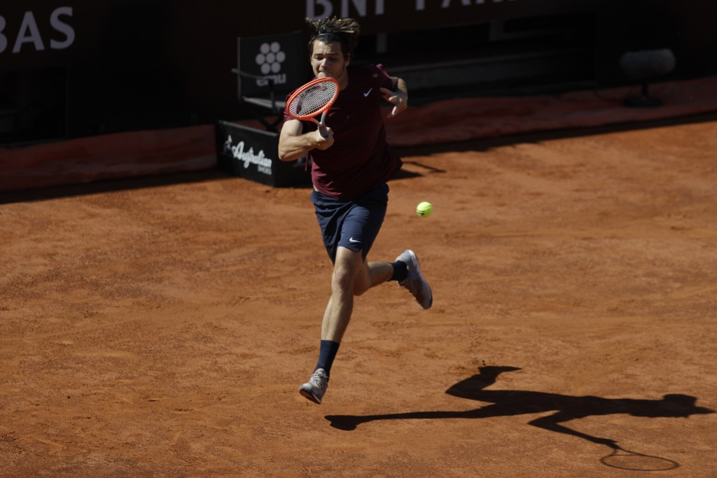 Taylor Fritz of the United States returns the ball to Britain's Daniel Evans during their match at the Italian Open tennis tournament, in Rome, Monday...