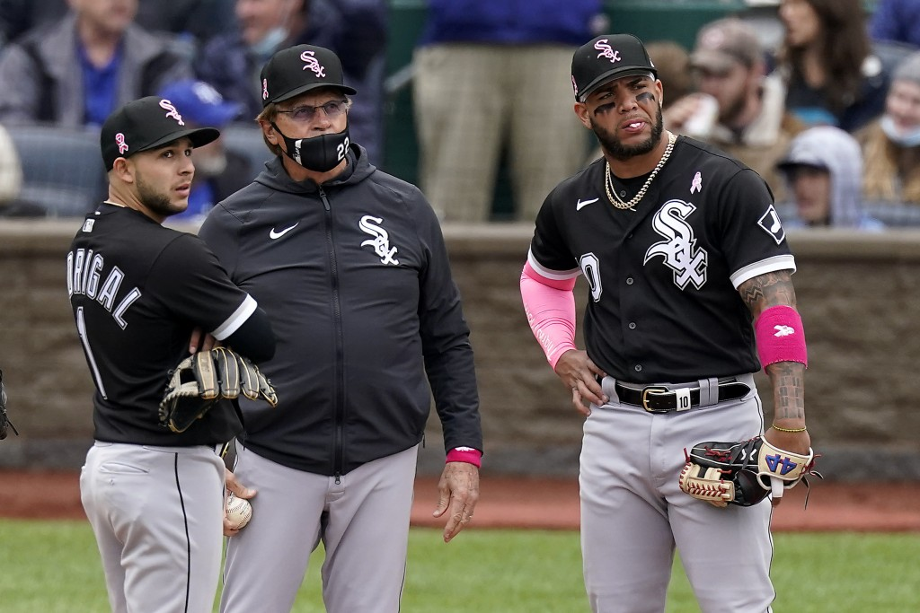 Chicago White Sox manager Tony La Russa, center, stands with Nick Madrigal, left, and Yoan Moncada, right, as he makes a pitching change during the si...