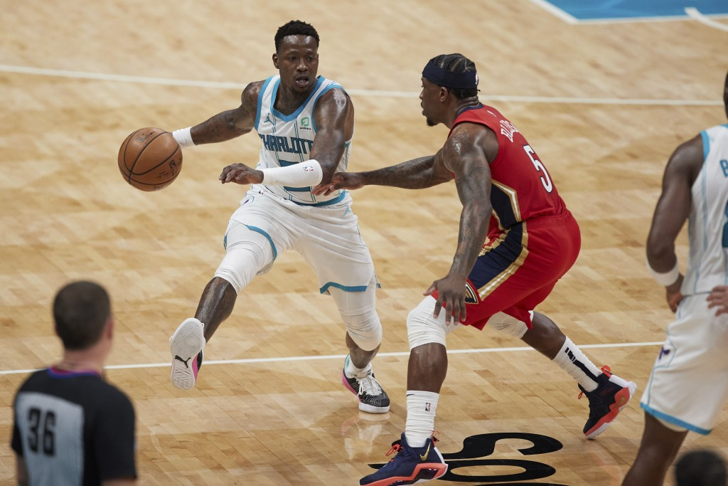 Charlotte Hornets guard Terry Rozier (3) is defended by New Orleans Pelicans guard Eric Bledsoe (5) during the second half of an NBA basketball game S...