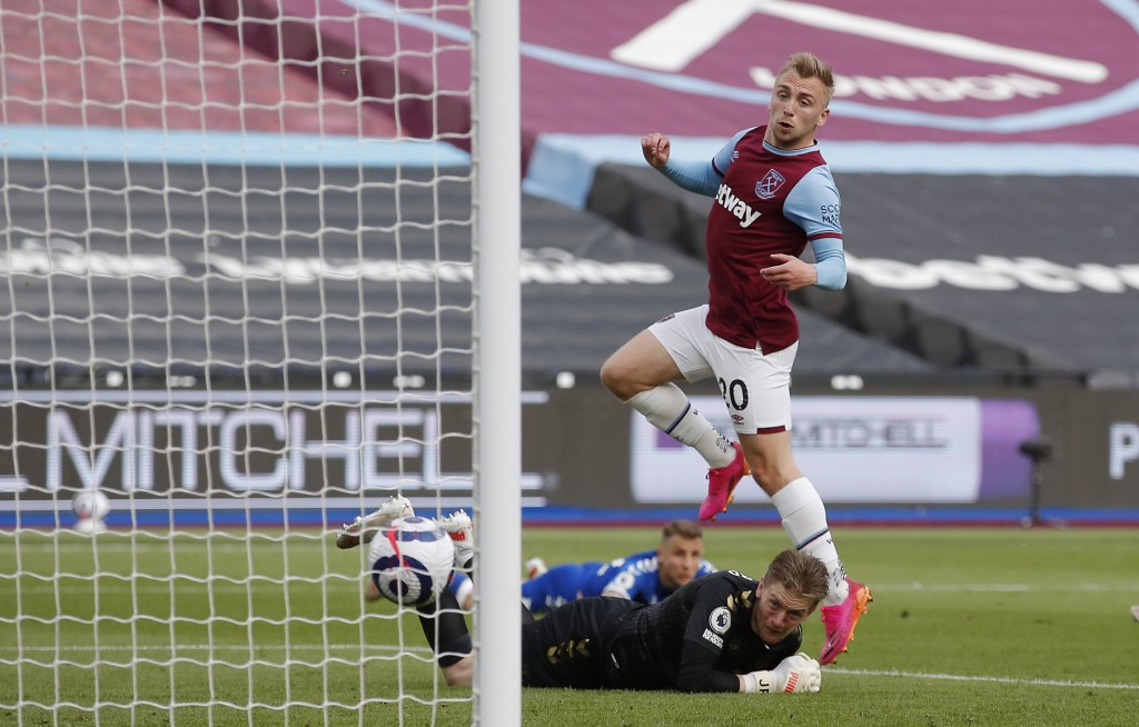West Ham's Jarrod Bowen, top, attempts to score during the English Premier League soccer match between West Ham United and Everton at London stadium i...