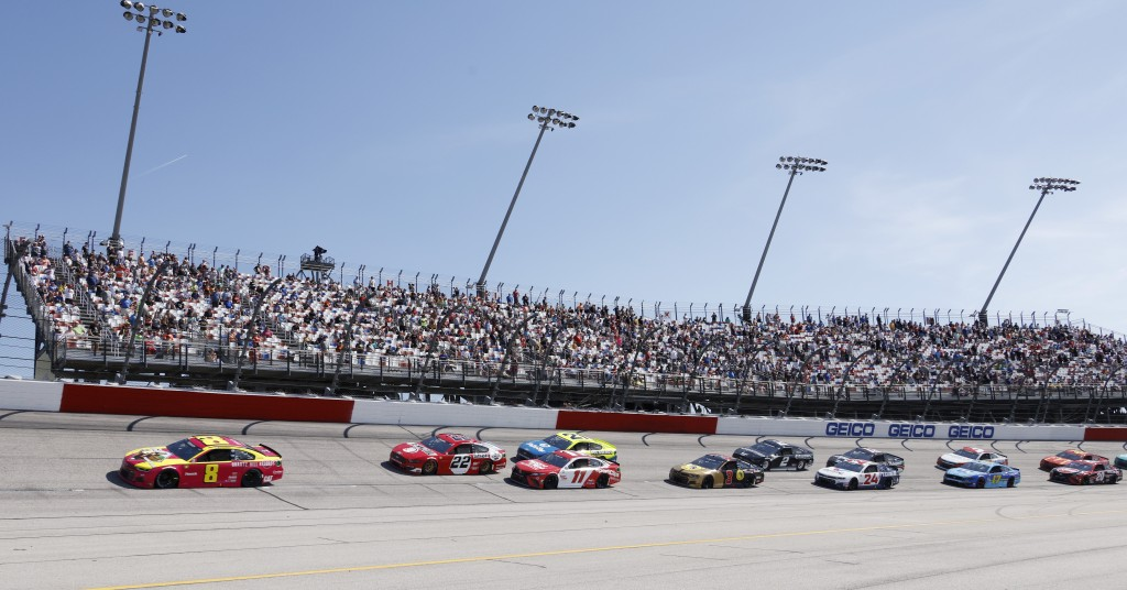 Tyler Reddick (8) leads the field past fans in the Turn 1 grandstands during the NASCAR Cup Series auto race at Darlington Raceway, Sunday, May 9, 202...