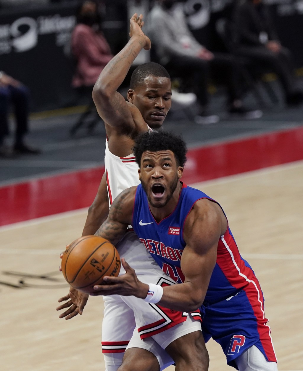 Detroit Pistons forward Saddiq Bey (41) looks towards the basket as Chicago Bulls guard Javonte Green defends during the first half of an NBA basketba...