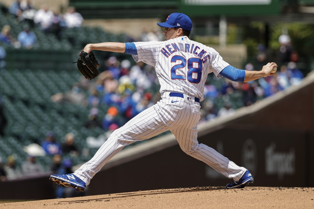 Chicago Cubs starting pitcher Kyle Hendricks (28) delivers against the Pittsburgh Pirates during the first inning of a baseball game, Sunday, May 9, 2...