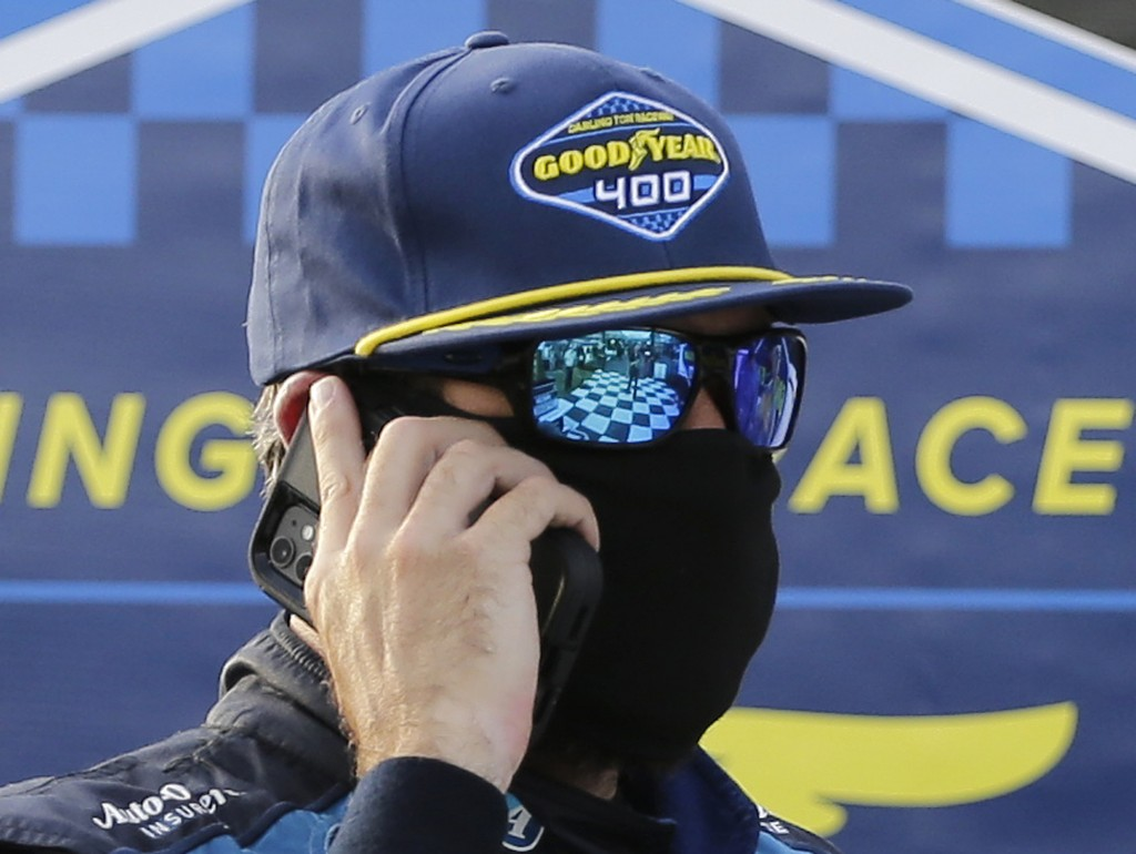 Martin Truex Jr. talks on a cell phone after winning the NASCAR Cup Series auto race at Darlington Raceway, Sunday, May 9, 2021, in Darlington, S.C. (...