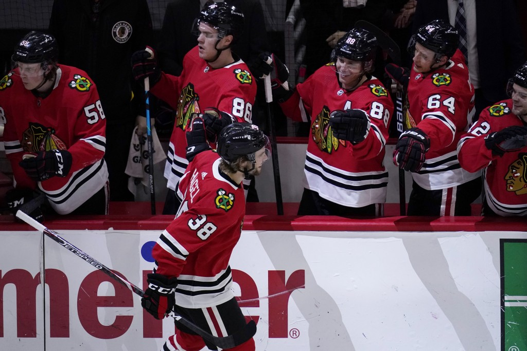 Chicago Blackhawks left wing Brandon Hagel (38) celebrates with teammates after scoring during the first period of the team's NHL hockey game against ...