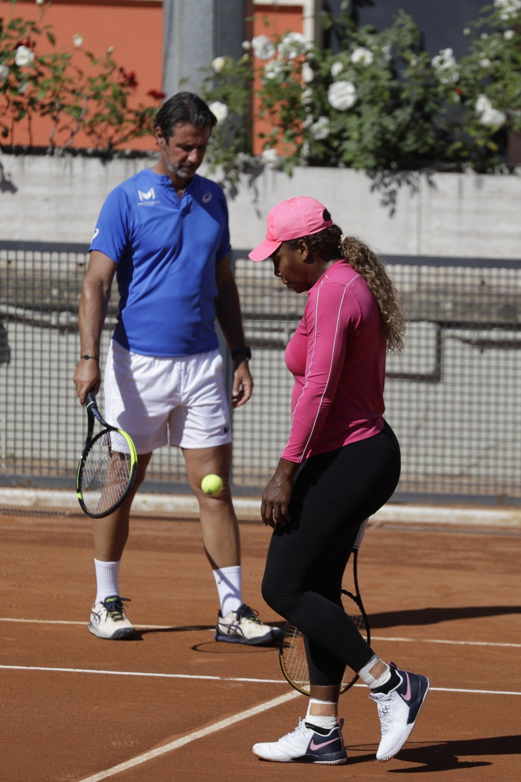 Serena Williams walks past her coach Patrick Mouratoglou during a training session at the Italian Open tennis tournament, in Rome, Monday, May 10, 202...