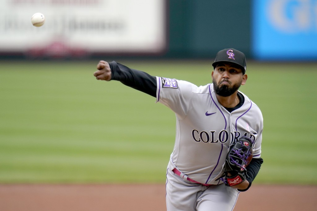 Colorado Rockies starting pitcher German Marquez throws during the first inning of a baseball game against the St. Louis Cardinals Sunday, May 9, 2021...