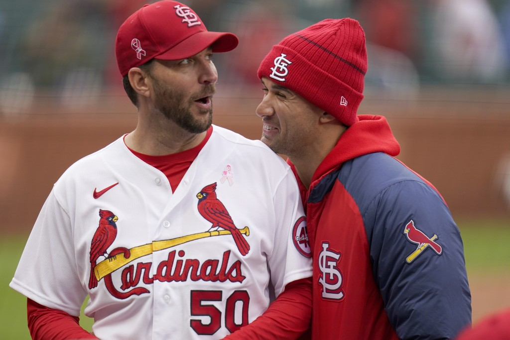 St. Louis Cardinals starting pitcher Adam Wainwright (50) celebrates with teammate Jack Flaherty following a 2-0 victory over the Colorado Rockies in ...