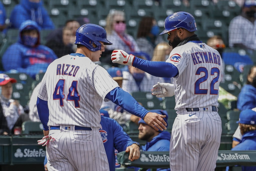 Chicago Cubs' Anthony Rizzo (44) celebrates with Jason Heyward (22) after scoring against the Pittsburgh Pirates during the fourth inning of a basebal...