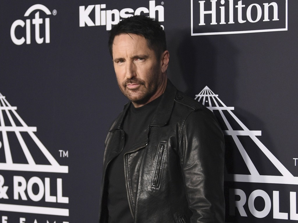 FILE - Trent Reznor arrives at the Rock & Roll Hall of Fame induction ceremony in New York on March 29, 2019. Reznor turns 56 on May 17. (Photo by Eva...
