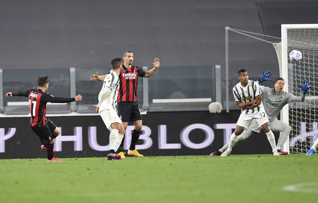 Inter Milan's Brahim Diaz, left, scores a goal during the Italian Serie A soccer match between Juventus and Milan, at the Juventus Stadium in Turin, I...