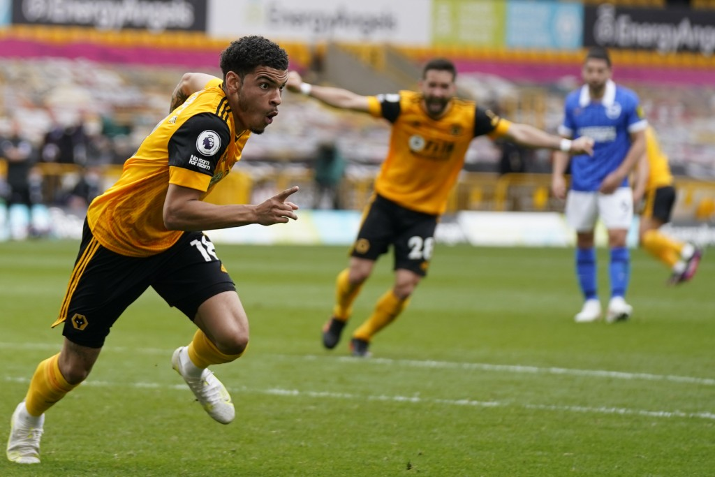 Wolverhampton Wanderers' Morgan Gibbs-White, left, celebrates after scoring his side's second goal during the English Premier League soccer match betw...