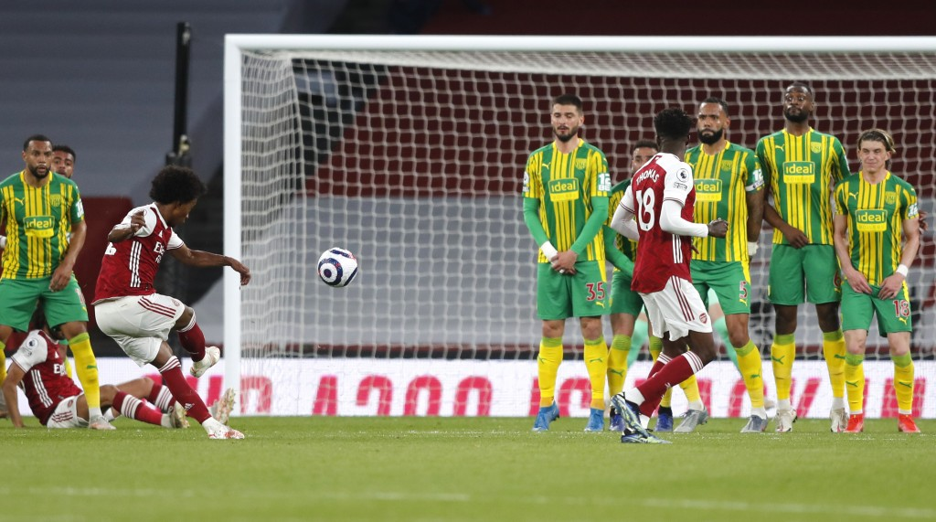 Arsenal's Willian scores his side's third goal during the English Premier League soccer match between Arsenal and West Bromwich Albion at the Emirates...