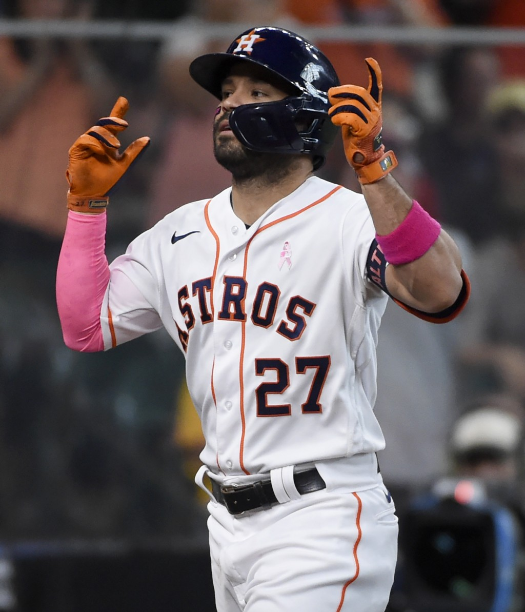 Houston Astros' Jose Altuve reacts after hitting a solo home run during the fourth inning of a baseball game against the Toronto Blue Jays, Sunday, Ma...