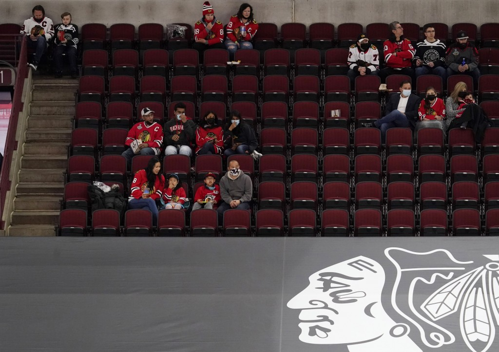 Fans watch during the third period of an NHL hockey game between the Dallas Stars and the Chicago Blackhawks in Chicago, Sunday, May 9, 2021. (AP Phot...
