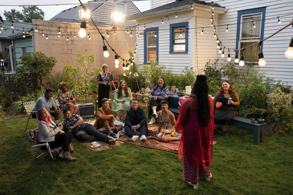 """This image released by Hulu shows Aidy Bryant, seated background center in green, in a scene from the Portland-set comedy series """"Shrill."""" (Allyson Ri..."""