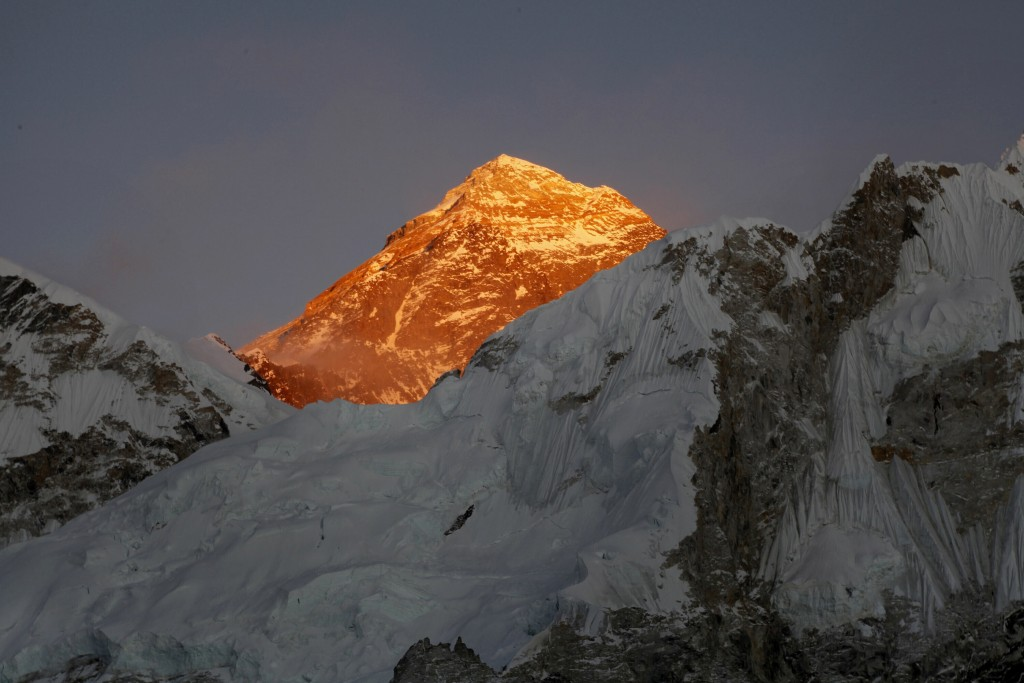"""FILE - In this Nov. 12, 2015, file photo, Mt. Everest is seen from the way to Kalapatthar in Nepal. China will draw a """"separation line"""" atop Mount Eve..."""