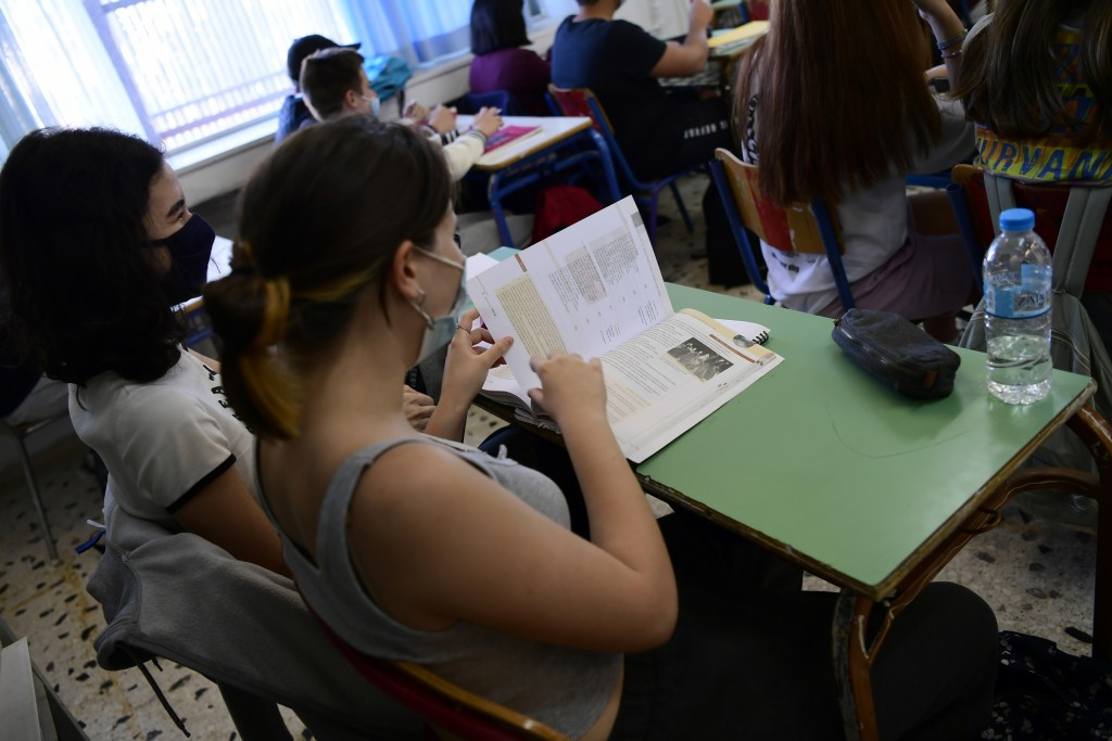 Students wearing face masks to help curb the spread of the coronavirus, open their books at a junior high school in Athens, Monday, May 10, 2021. More...