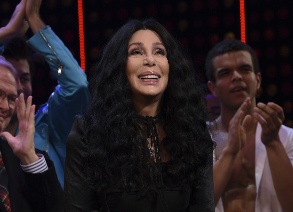 """FILE - Cher appears at the curtain call for """"The Cher Show"""" Broadway musical opening night in New York on Dec. 3, 2018. Cher turns 75 on May 20. (Phot..."""