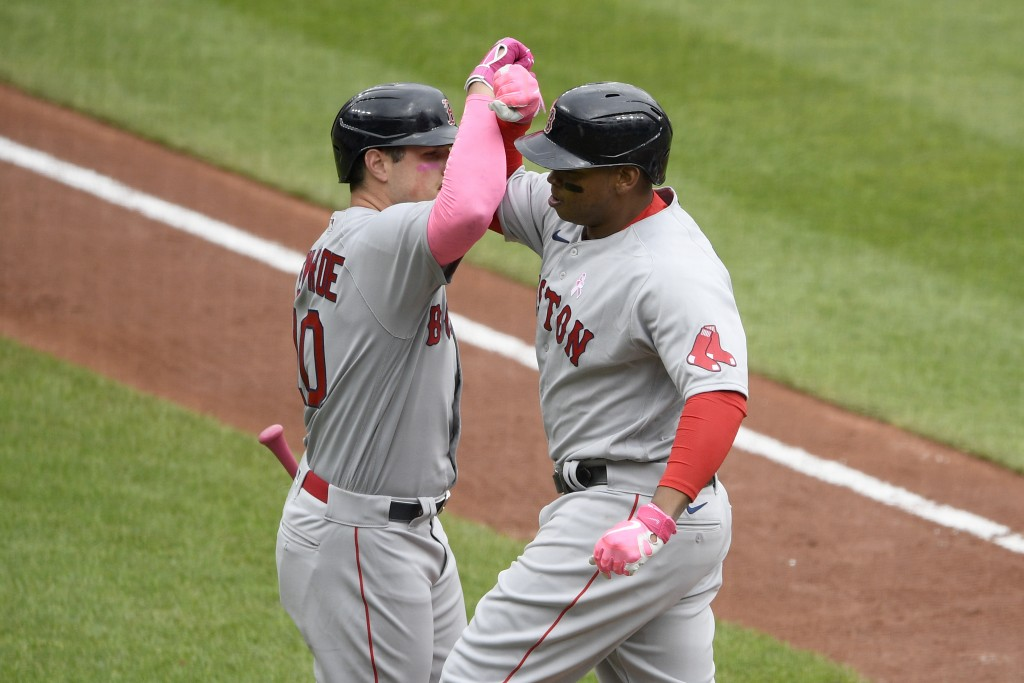 Boston Red Sox's Rafael Devers, right, celebrates his home run with Hunter Renfroe, left, during the second inning of a baseball game against the Balt...