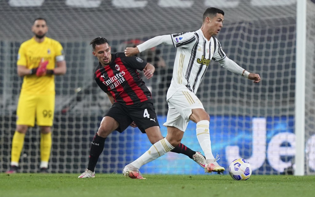 Milan's Ismael Bennacer, left, battles for the ball with Juventus' Cristiano Ronaldo during the Italian Serie A soccer match between Juventus and Mila...