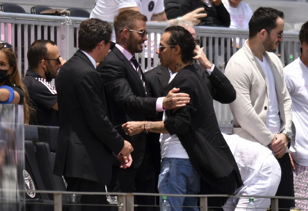 David Beckham, center left, owner and president of soccer operations for Inter Miami, greets artist Marc Anthony, center right, before an MLS soccer m...