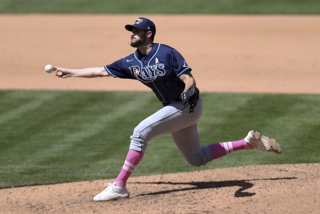 Tampa Bay Rays' Ryan Thompson throws to an Oakland Athletics batter during the seventh inning of a baseball game in Oakland, Calif., Sunday, May 9, 20...