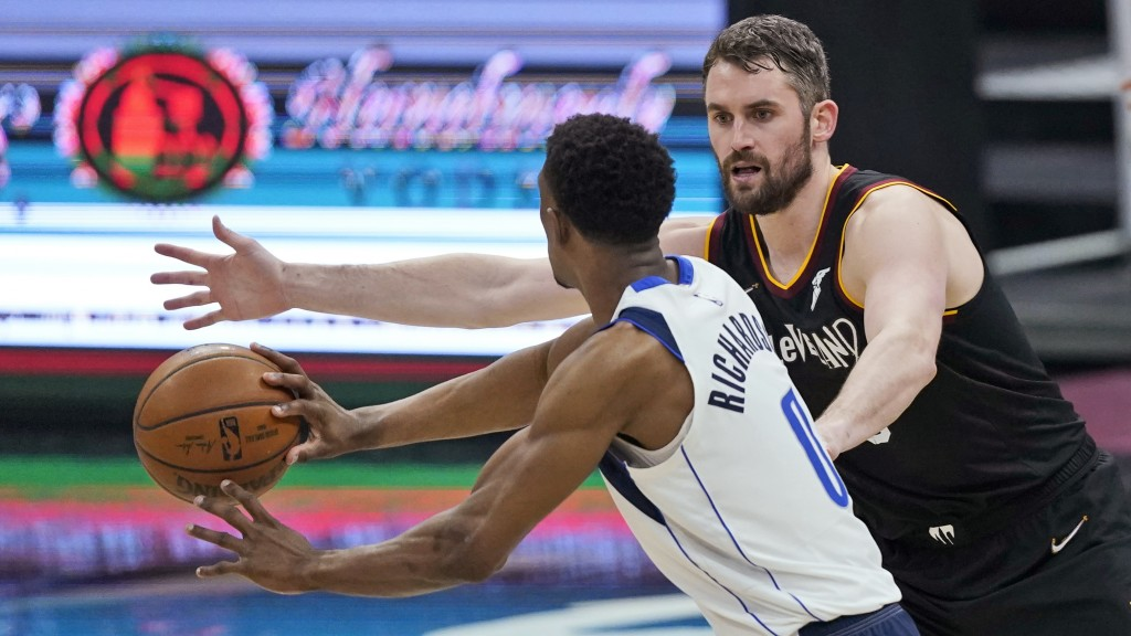 Cleveland Cavaliers' Kevin Love (0) defends against Dallas Mavericks' Josh Richardson (0) during the first half of an NBA basketball game Sunday, May ...