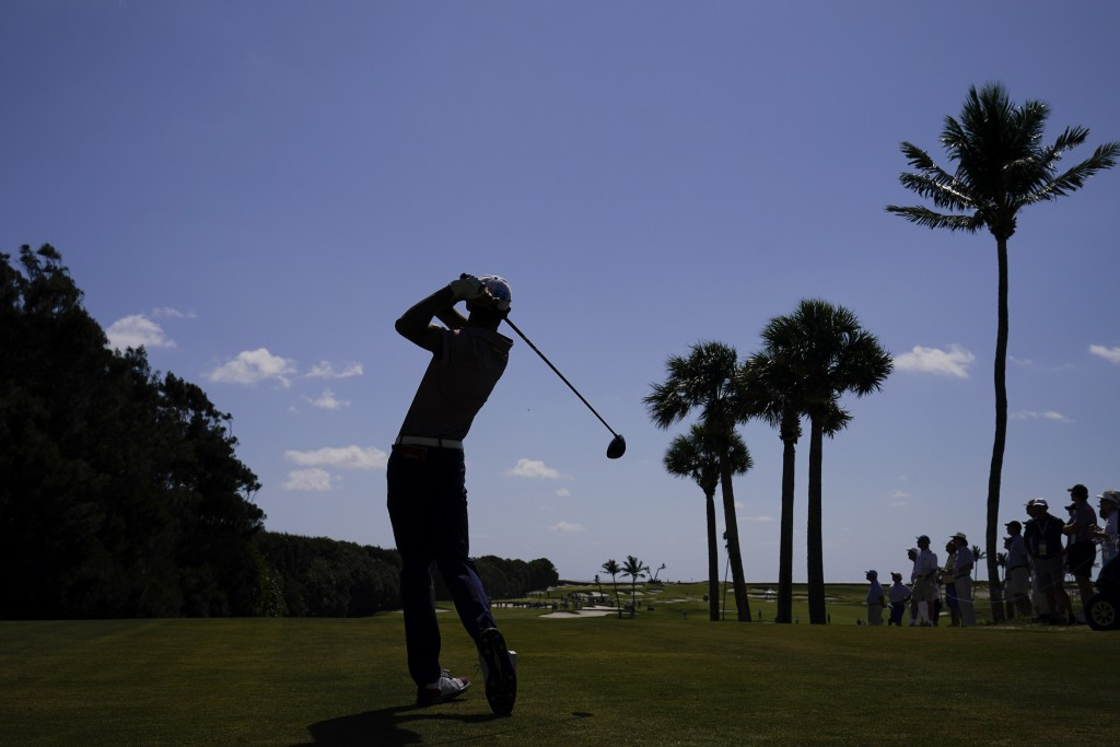 Ricky Castillo, of the USA team, watches his tee shot on the 12th hole in the foursome matches during the Walker Cup golf tournament at the Seminole G...