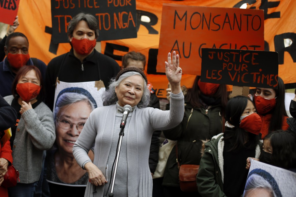 FILE - In this Jan.30, 2021 file photo, Tran To Nga waves as she delivers a speech during a gathering in support of people exposed to Agent Orange dur...