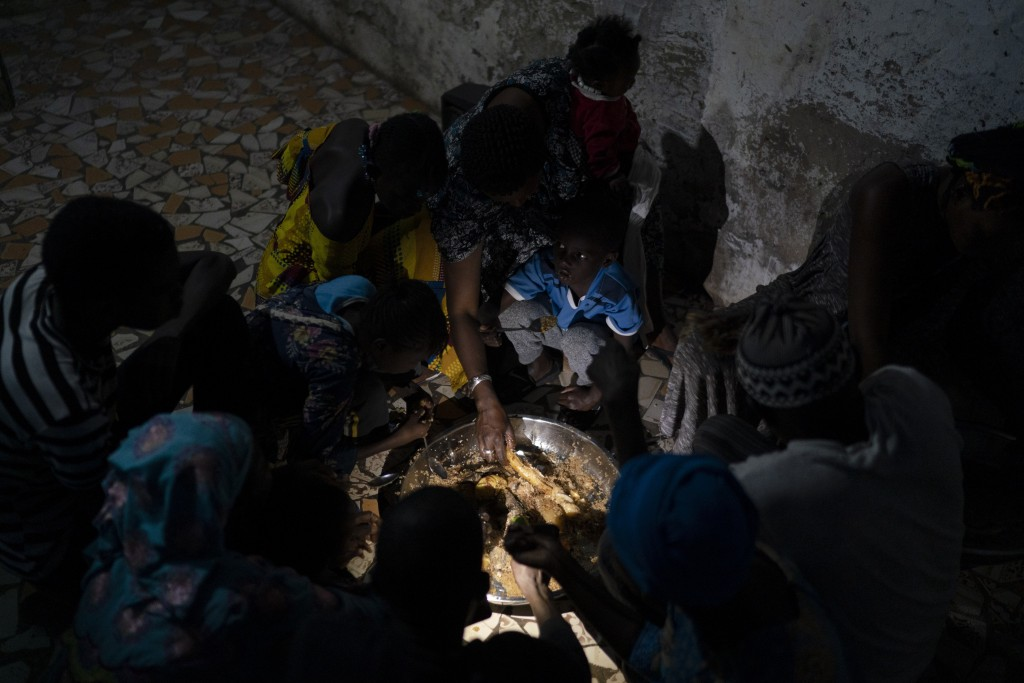 Ndeye Yacine Dieng breaks the fast with her family during the holy month of Ramadan at her home in Bargny, Senegal some 35 kilometers (22 miles) east ...