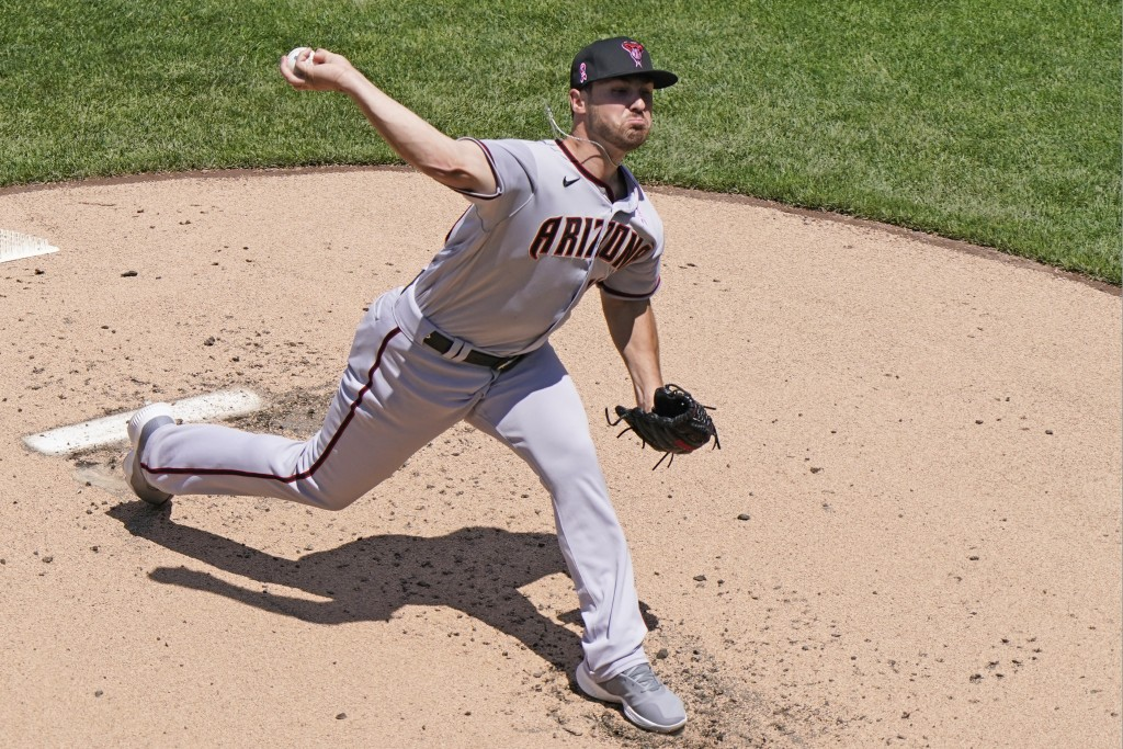 Arizona Diamondbacks starting pitcher Riley Smith delivers during the first inning of a baseball game against the New York Mets, Sunday, May 9, 2021, ...