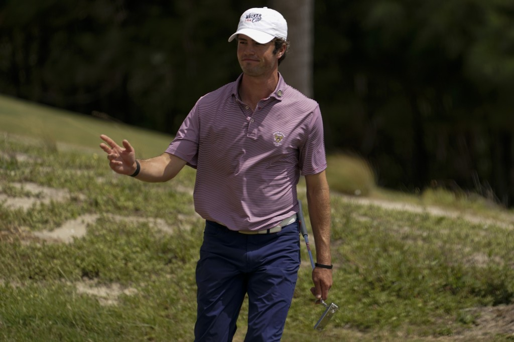 Cole Hammer, of the USA team, waves after making a putt on the 14th hole in the foursome matches during the Walker Cup golf tournament at the Seminole...