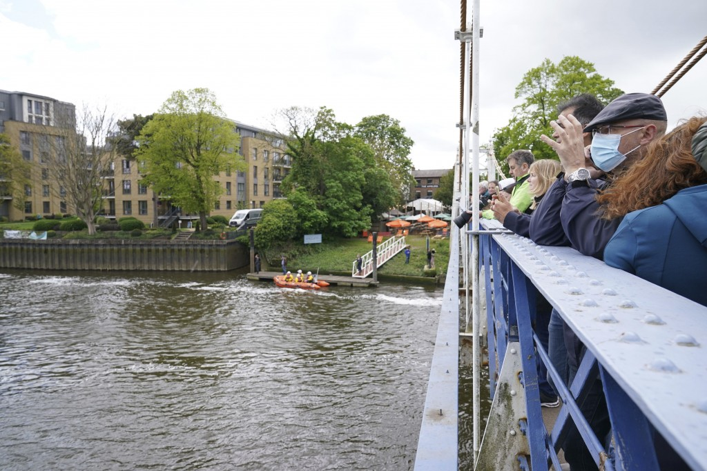 An RNLI boat and crew prepare whilst people gather to spot Minke whale, which was freed on Sunday after it became stuck on Richmond lock's boat roller...